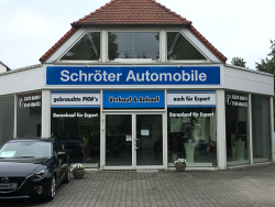 Schröter Automobile-Fassadenschild und Scheibenbeschriftung